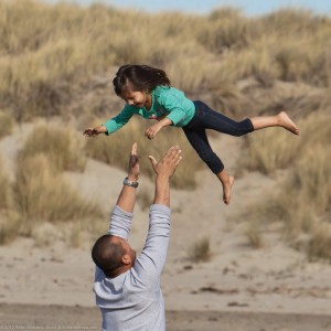love_and_trust__father_tosses_his_confident_daughter_into_to_air_accompanied_by_screams_of_delight-300x300